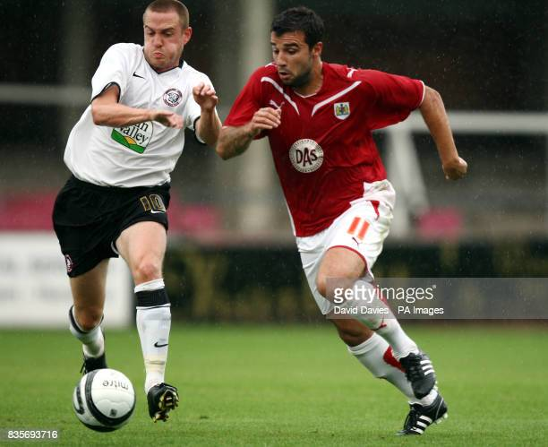 Bristol City's Alex Eremenko Jnr challenges Hereford United's Lee Morris during the Friendly match at Edgar Street Hereford