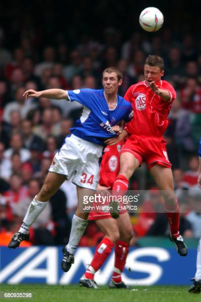 Bristol City's Danny Coles and Carlisle United's Craif Farrell battle for the ball