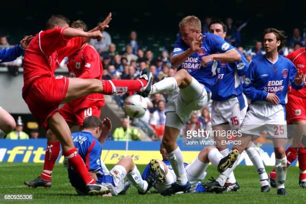 Bristol City's Danny Coles Carlisle United's Paul Raven battle for the ball