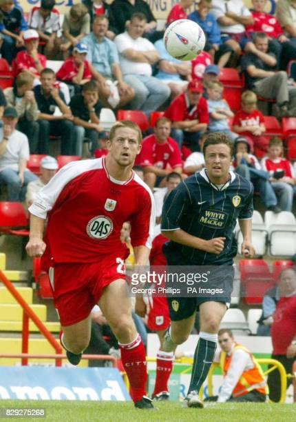 Bristol City's Darren Jones and Leeds United's Jamie McMaster give chase to the loose ball during a preseason friendly game at the Ashton Gate...