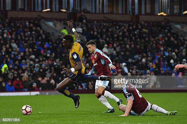 Bristol City's English Striker Tammy Abraham is tackled by Burnley's English defender Ben Mee during the English FA Cup fourth round football match...