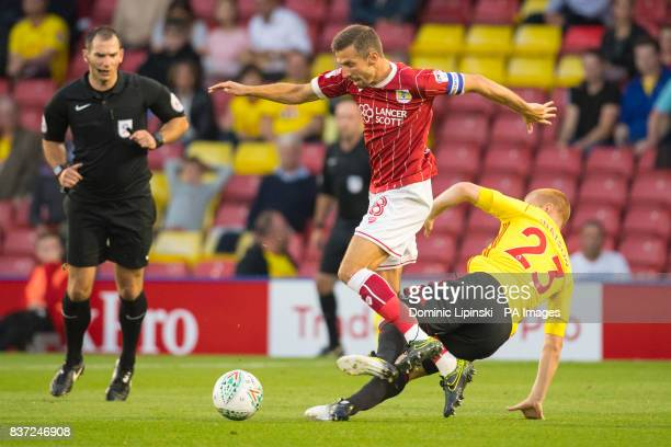 Bristol City's Gary O'Neill and Watford's Ben Watson battle for the ball during the Carabao Cup Second Round match at Vicarage Road Watford
