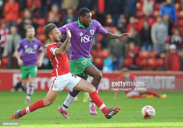 Bristol City's Jay EmmanuelThomas is tackled by Barnsley's Conor Hourihane