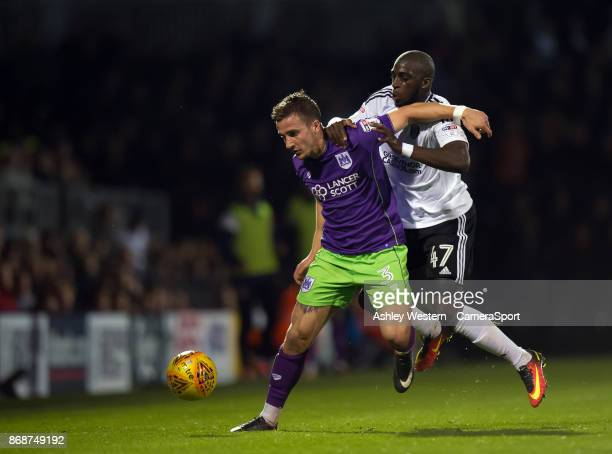 Bristol City's Joe Bryan holds off the challenge from Fulham's Aboubakar Kamara during the Sky Bet Championship match between Fulham and Bristol City...