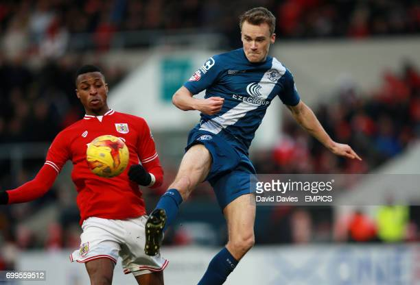 Bristol City's Jonathan Kodjia and Birmingham City's Maikel Kieftenbeld battle for the ball