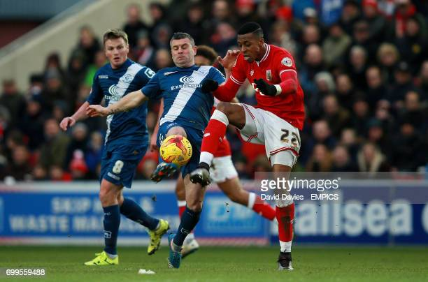 Bristol City's Jonathan Kodjia and Birmingham City's Paul Robinson battle for the ball