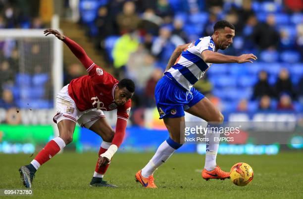 Bristol City's Jonathan Kodjia and Reading's Anton Ferdinand battle for the ball