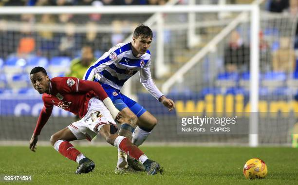 Bristol City's Jonathan Kodjia and Reading's Jake Cooper in action