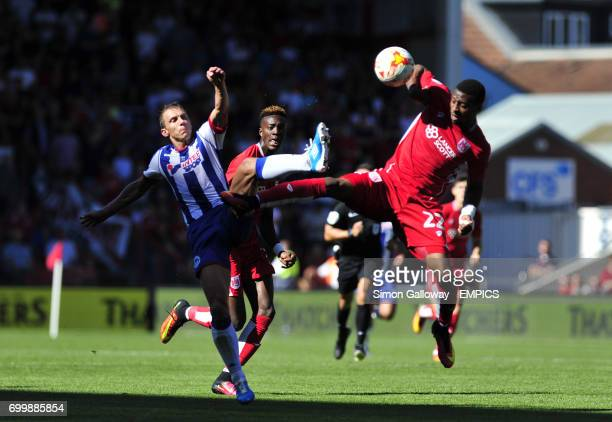 Bristol City's Jonathan Kodjia and Wigan Athletic's Stephen Warnock in action