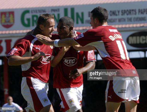 Bristol City's Lee trundle celebrates his first goal against Scunthorpe with Teamates Bradley Orr amd Micheal Mcindoe during the CocaCola Football...