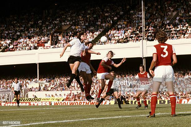 Bristol City's Paul Cheesley beats Arsenal's Peter Simpson and John Radford in the air to head for goal watched by teammate Geoff Merrick and...