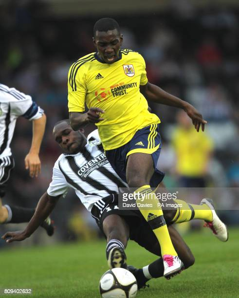 Bristol City's Yannick Bolasie is tackled by Forest Green Rovers' Kieron Forbes during the PreSeason Friendly at The New Lawn Gloucestershire