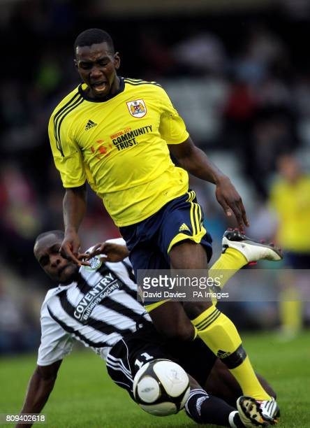 Bristol City's Yannick Bolasie is tackled by Kieron Forbes of Forest green Rovers during the pre season friendly match at the New Lawn Forest Green...