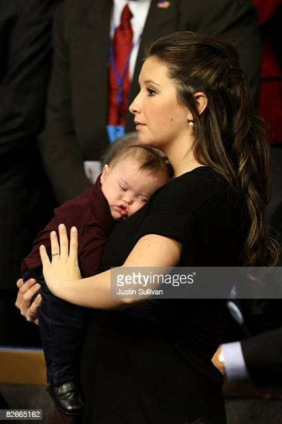 Bristol Palin daughter of Republican US vicepresidential nominee Alaska Gov Sarah Palin holds brother Trig Palin on day four of the Republican...