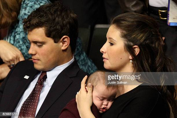 Bristol Palin daughter of Republican US vicepresidential nominee Alaska Gov Sarah Palin holds brother Trig Palin while sitting next to her boyfriend...