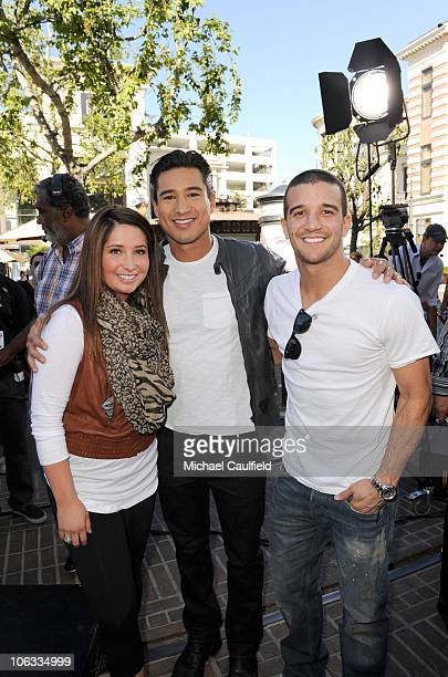 Bristol Palin Mario Lopez and Mark Ballas pose on the set of 'Extra' at the Grove on October 28 2010 in Los Angeles California