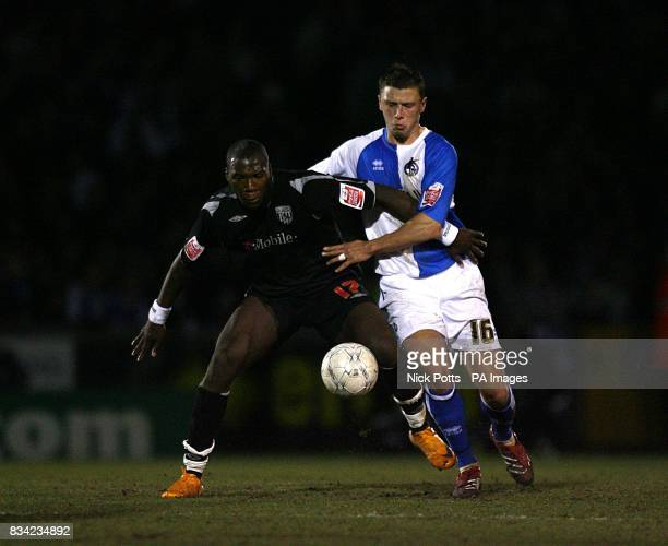 Bristol Rovers' Danny Coles and West Bromwich Albion's Ishmael Miller battle for the ball
