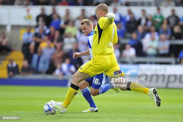 Bristol Rovers Eliot Richards and Morecambe's goalkeeper Barry Roche in action during the npower Football League Two match at the Memorial Stadium...