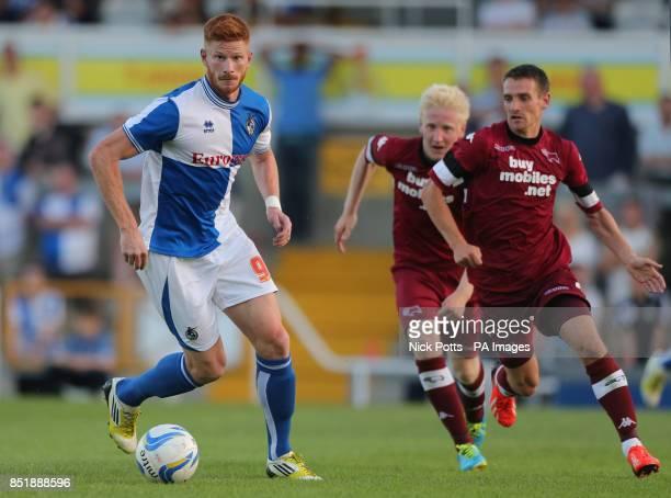 Bristol Rovers' Matt Harrold turns away from Derby pair Craig Bryson and Will Hughes