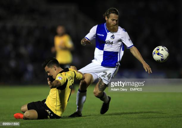 Bristol Rovers' Stuart Sinclair and Bolton Wanderers' Zach Clough battle for the ball