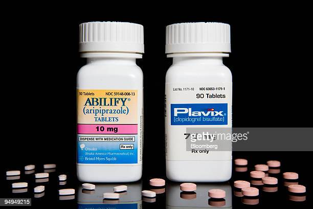 BristolMyers Squibb's Abilify and Plavix drugs are arranged for a photograph at New London Pharmacy in New York US on Tuesday April 28 2009...