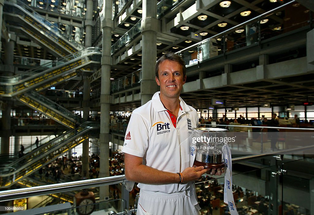 Brit Insurance Cricketer of the Year Graeme Swann poses with his trophy during a visit to the Lloyds Financial Building on May 24, 2010 in London, England.