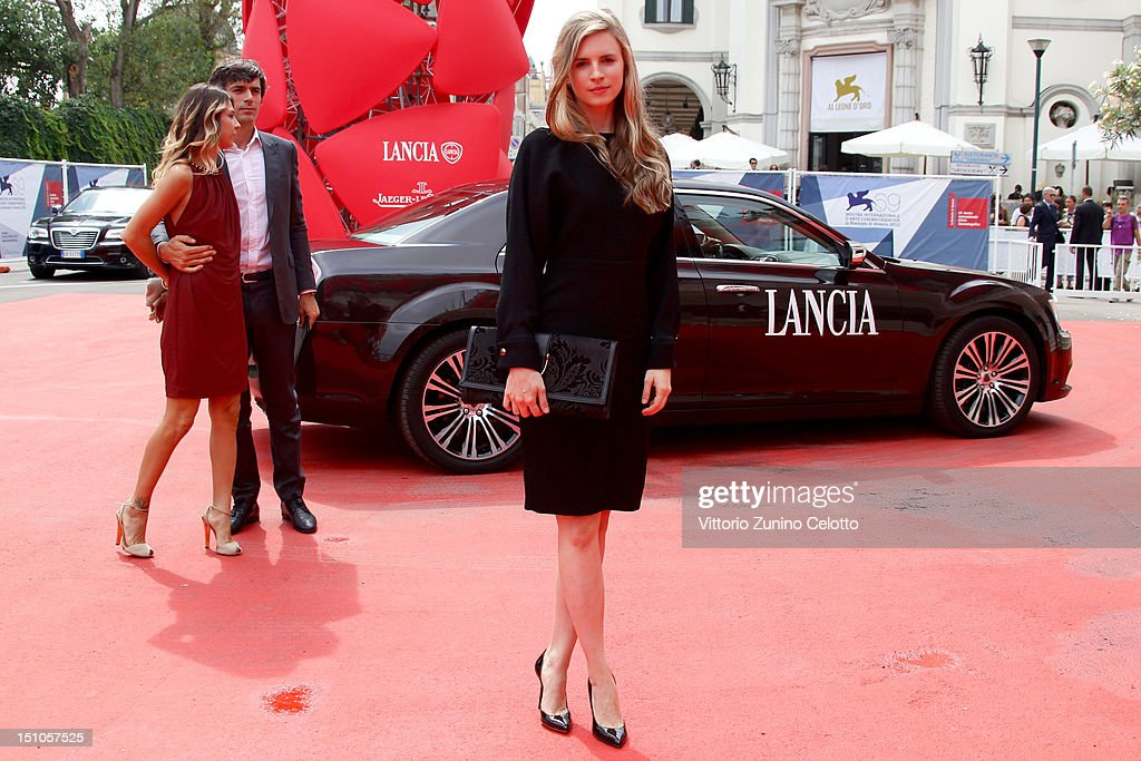 <a gi-track='captionPersonalityLinkClicked' href=/galleries/search?phrase=Brit+Marling&family=editorial&specificpeople=701867 ng-click='$event.stopPropagation()'>Brit Marling</a> attends World Restoration Premiere Of 'The Mattei Affair' at The 69th Venice International Film Festival at the Palazzo del Cinema on August 31, 2012 in Venice, Italy.