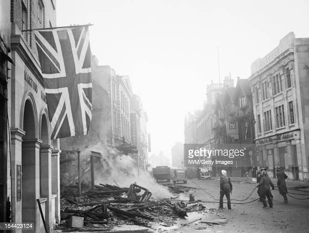 Britain At War 193945 A Union Flag hangs defiantly from a building 16 November 1940 in the aftermath of the air raid which devastated the centre of...