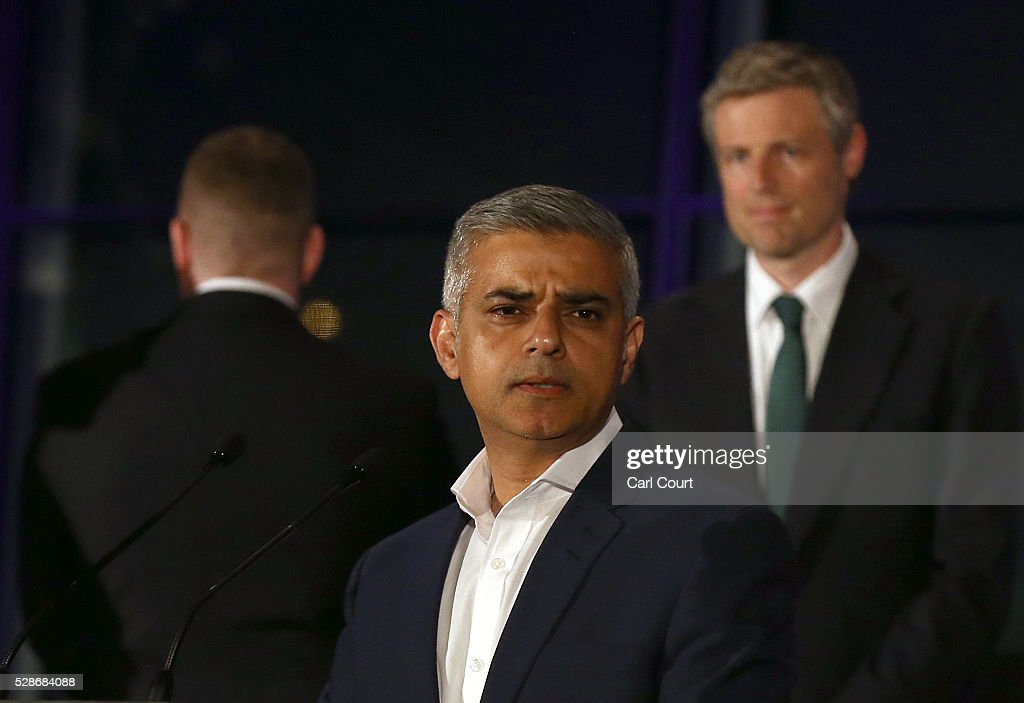 Britain First mayoral candidate, Paul Golding (L), turns his back as Labour mayoral candidate Sadiq Khan makes a speech after being announced as London mayor following local elections, on May 07, 2016 in London, England. After months of campaigning Mr Khan won the London mayoral race with 56.8 percent of the vote beating Conservative Party candidate Zac Goldsmith into second place.