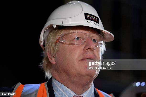 Britain Foreign Secretary Boris Johnson wears protective eyewear and a hard hat as he tours construction work underway at the Joan Sutherland Theatre...