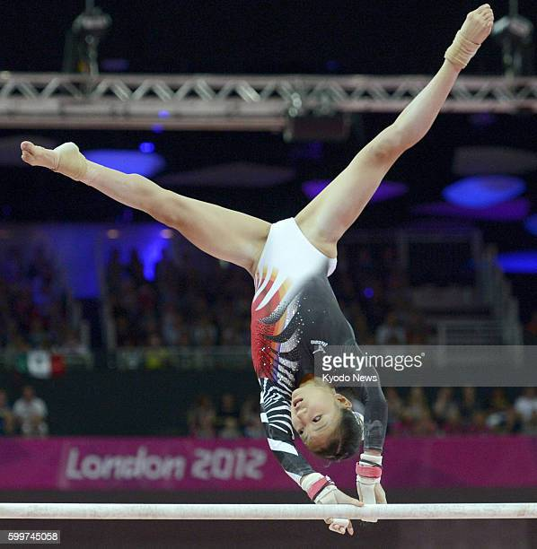 LONDON Britain Japan's Asuka Teramoto performs on the uneven bars during the women's gymnastics allaround final at the 2012 London Olympics at North...