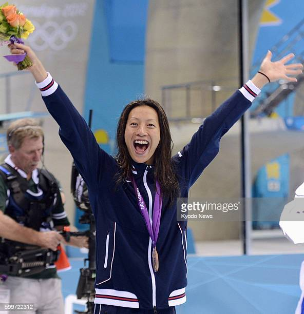 LONDON Britain Japan's Aya Terakawa celebrates after winning the bronze medal in the women's 100meter backstroke at the 2012 London Olympics at...