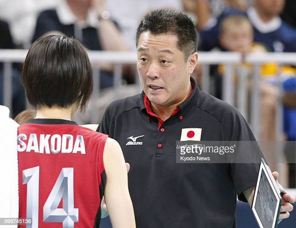 LONDON Britain Japan's coach Masayoshi Manabe gives instructions to Saori Sakoda during the third set of a match against Russia in the Olympic...