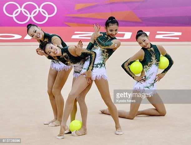 LONDON Britain Japan's Natsuki Fukase Rie Matsubara Nina Saeed Yokota and Airi Hatakeyama perform with balls during the rhythmic gymnastics team...