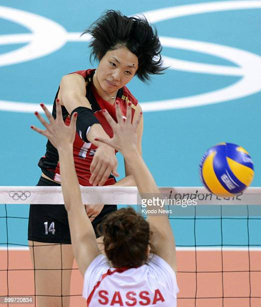 LONDON Britain Japan's Saori Sakoda spikes the ball during the first set of a match against Algeria in the women's Olympic volleyball tournament at...