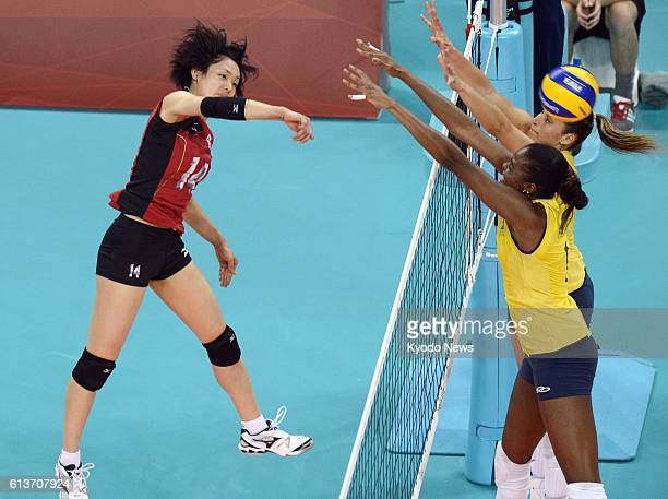 LONDON Britain Japan's Saori Sakoda spikes the ball during the second set of a match against Brazil in the women's volleyball semifinals at Earls...