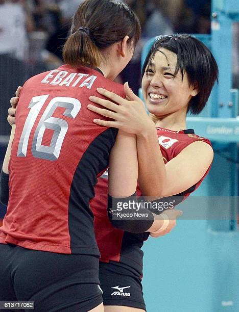 LONDON Britain Japan's Yukiko Ebata hugs Saori Sakoda after beating South Korea in straight sets 2522 2624 2521 in the women's volleyball bronze...