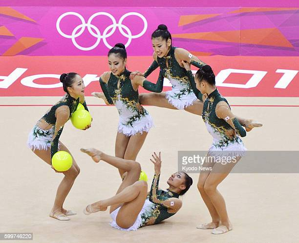 LONDON Britain Members of the Japanese team perform with the balls during the first day of a twoday rhythmic gymnastics group qualification at...