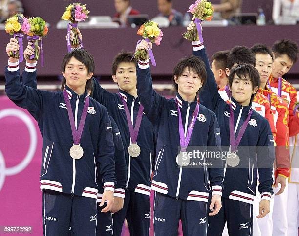 LONDON Britain Members of the Japanese team Yusuke Tanaka Kazuhito Tanaka Kohei Uchimura and Ryohei Kato wave to the crowd after winning the silver...