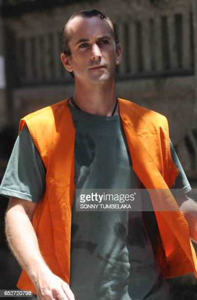 CORRECTION Britain national David Taylor walks to holding for his trial in Denpasar on Indonesia's resort island of Bali on March 13 2017 Taylor was...