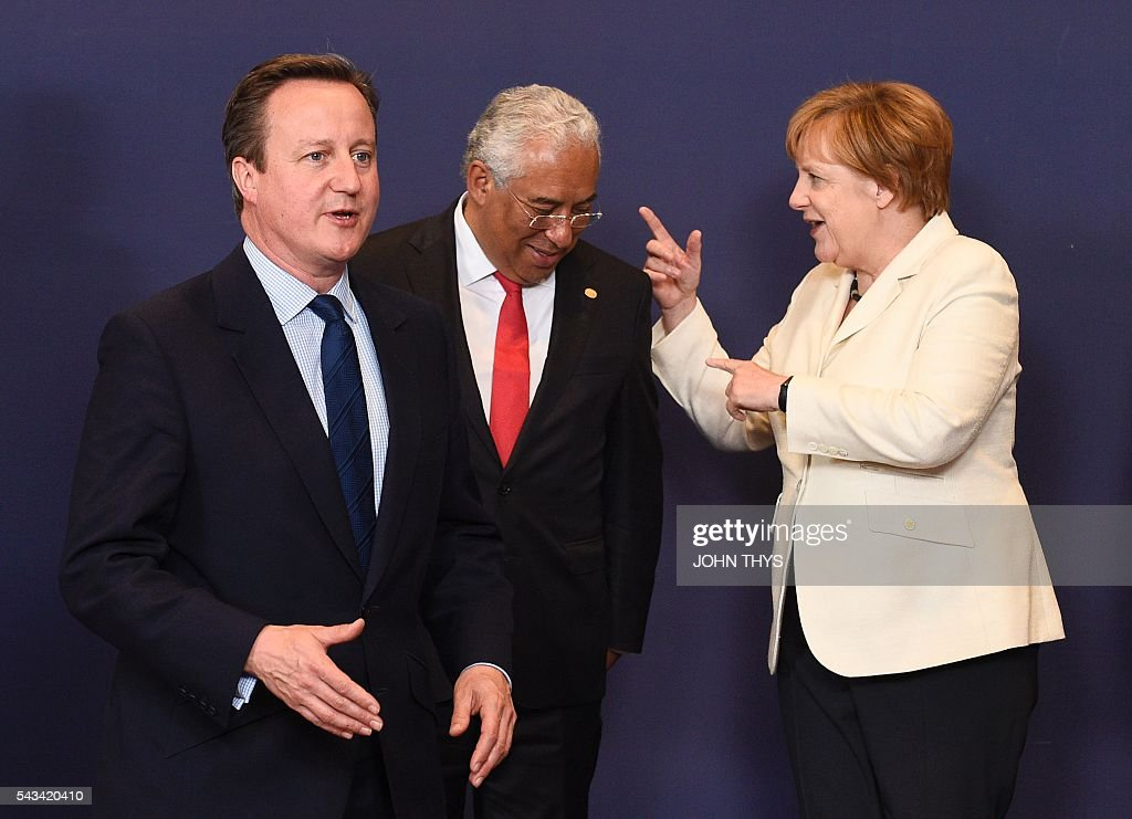 Britain Prime minister David Cameron (L) gestures as Portuguese Prime minister Antonio Costa (C) talks with German Chancellor Angela Merkel (R) during EU - Summit at the EU headquarters in Brussels on June 28, 2016. Prime Minister David Cameron said today he wants the 'closest possible' relations with the EU after Britain voted to leave the bloc, adding the split should be 'as constructive as possible'. As he arrived at a Brussels summit, Cameron, who is to step down within weeks, told reporters that, while Britain was leaving the EU, 'we mustn't be turning our backs on Europe.' THYS
