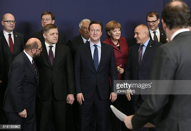 Britain Prime minister David Cameron looks up as German Chancellor Angela Merkel shares a light moment with Bulgarian Prime minister Roesen...