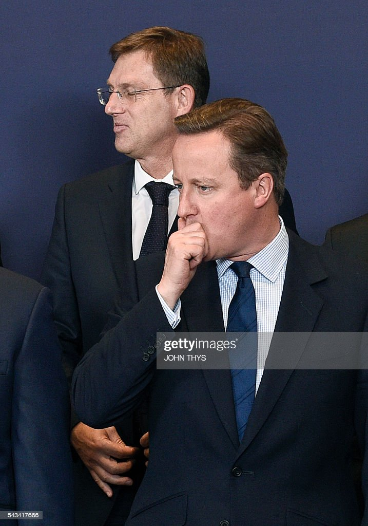 Britain Prime minister David Cameron poses for a family picture during EU - Summit at the EU headquarters in Brussels on June 28, 2016. Prime Minister David Cameron said Tuesday he wants the 'closest possible' relations with the EU after Britain voted to leave the bloc, adding the split should be 'as constructive as possible'. As he arrived at a Brussels summit, Cameron, who is to step down within weeks, told reporters that, while Britain was leaving the EU, 'we mustn't be turning our backs on Europe.' THYS