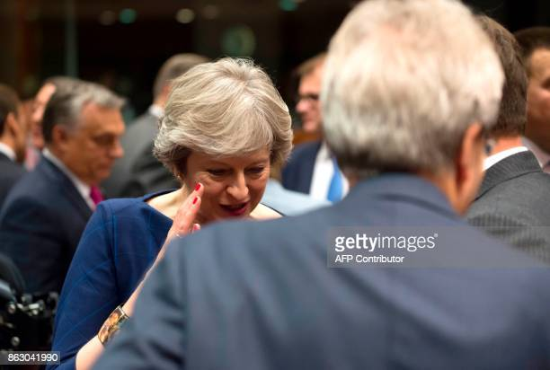 Britain Prime minister Theresa May gestures as she talks with Luxembourg Prime minister in Brussels on October 19 2017 during a summit of European...