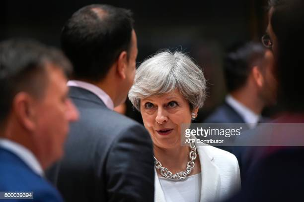 Britain Prime minister Theresa May talks with Irish Prime minister Leo Varadkar during a European Council meeting on the second day of a summit of...