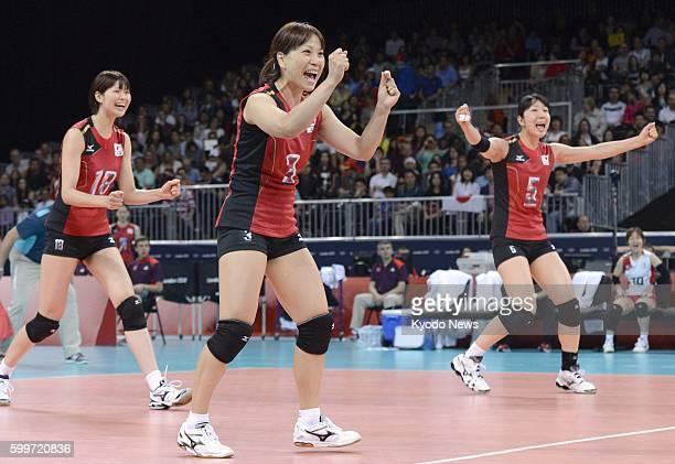 LONDON Britain Saori Kimura Yoshie Takeshita and Erika Araki rejoice after the team scored during the third set of a match against Algeria in the...