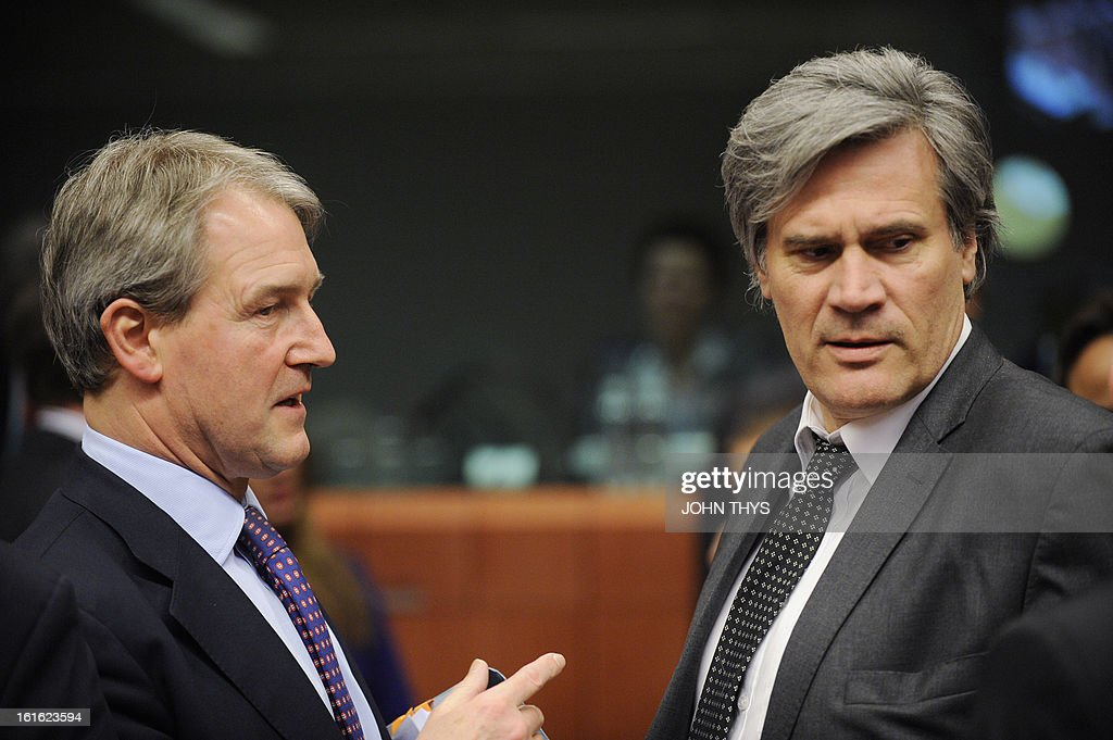 Britain Secretary of State for the Environment, Food and Rural Affairs Owen William Paterson (L) talks with French Agriculture Minister Stephane Le Foll during an informal agriculture meeting on 'Mislabelling of meat products' on February 13, 2013 at the EU headquarters in Brussels. European farming ministers and the European commissioner for health were due to meet in Brussels amid growing anger and recriminations over mislabelled meat products. The EU meeting comes a day after British police searching for the source of horsemeat in kebabs and burgers raided two meat plants, the first such operation since the scandal spread across Europe.