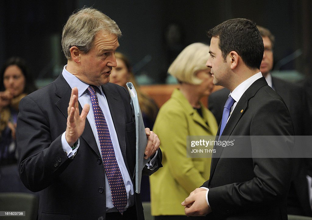 Britain Secretary of State for the Environment, Food and Rural Affairs Owen William Paterson (L) talks with Romanian Minister of Agriculture Daniel Constantin during an informal agriculture meeting on 'Mislabelling of meat products' on February 13, 2013 at the EU headquarters in Brussels. European farming ministers and the European commissioner for health were due to meet in Brussels amid growing anger and recriminations over mislabelled meat products. The EU meeting comes a day after British police searching for the source of horsemeat in kebabs and burgers raided two meat plants, the first such operation since the scandal spread across Europe.