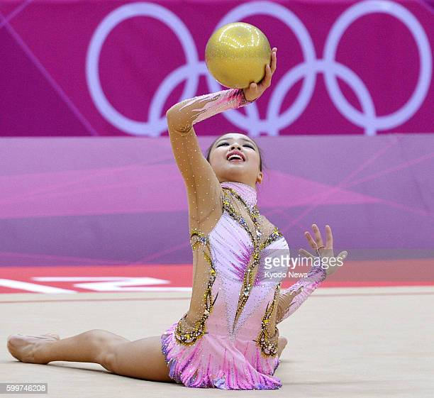 LONDON Britain South Korea's Son Yeon Jae performs with the ball during the first day of a twoday rhythmic gymnastics individual allaround...