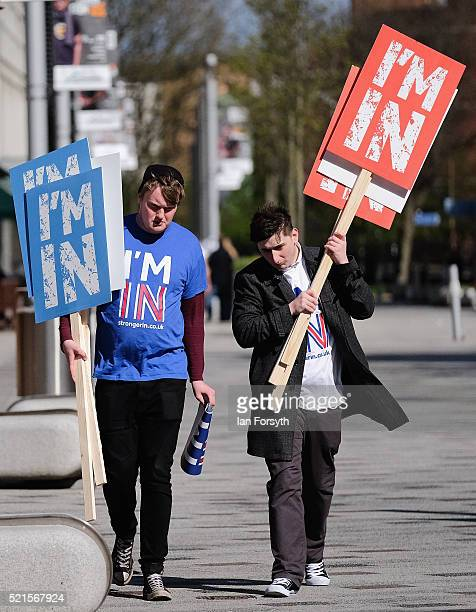 Britain Stronger In Europe supporters carry placards as the campaign bus arrives at Northumbria University's City Campus on April 16 2016 in...